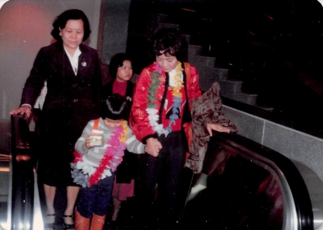 12/31/79: Moving to the US to join my dad. That's my grandmother (mom's side) behind me.